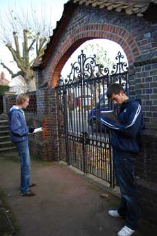 Students examining a park gate