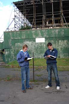 Students standing in front of a derelict park building