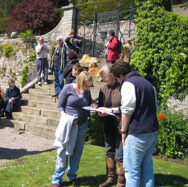 People in a garden at Bolton Abbey, North Yorkshire, being trained in how to record historic gardens.