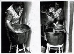 A woman making cheese by hand in the doorway of her cottage.